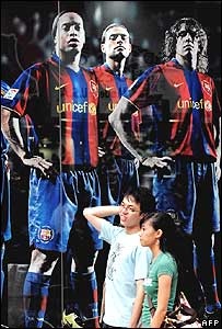 Advertisement showing Barcelona players