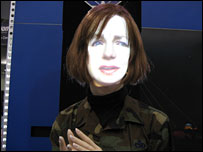 Projection of a woman speaking with humanoid body