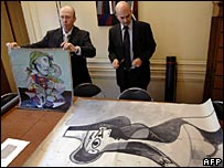 Two police officers with the Picasso works which were stolen