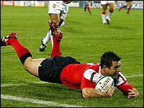 Gareth Cooper scores against Tonga in 2003