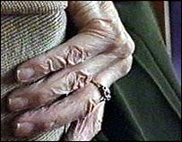 Elderly hand on a chair