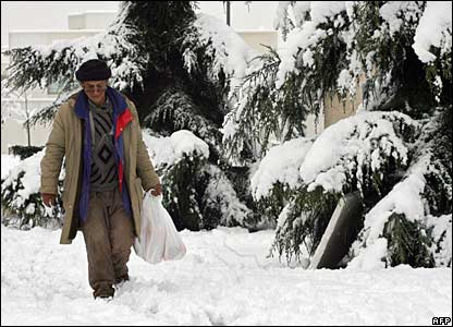 A woman walks in a snow-covered Santiago on 9 August 2007