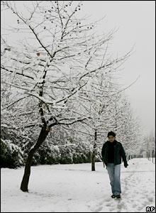 A man walks in a park in Santiago on 9 August 2007