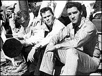 Sonny West (left) and Elvis Presley