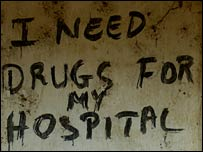 Graffiti on the wall of a building which reads, 'I need drugs for my hospital' (Photo: Aubrey Wade)