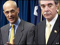 Homeland Security Secretary Michael Chertoff (L) with Commerce Secretary Carlos Gutierrez