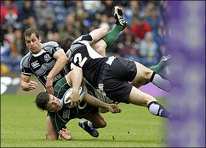 Scotland's Chris Paterson tackles Ireland's Brian O'Driscoll