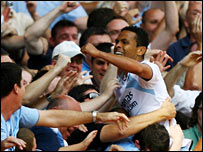 Geovanni celebrates with fans after scoring City's second goal
