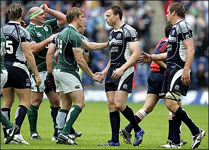 Andy Henderson (centre) shakes hands after helping Scotland beat Ireland