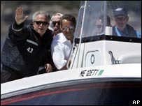 President George W Bush and French President Nicolas Sarkozy ride aboard Fidelity III driven by former President George H W Bush, 11 August 2007