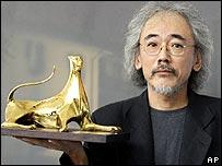 Masahiro Kobayashi holding award