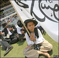 A Indonesian boy holds a flag with Arabic writing during the International Caliphate Conference 2007 in Jakarta.