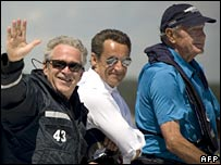 US President George W Bush takes French President Nicholas Sarkozy on a boat trip off Maine, driven by former US President George H Bush, 11 August 2007