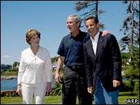 US President George W Bush and his wife Laura welcome French President Nicholas Sarkozy to Maine, 11 August 2007