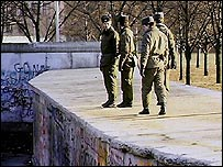 East German border guards on the Berlin Wall (1989)