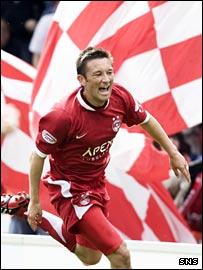 Barry Nicholson celebrates his goal against Hearts