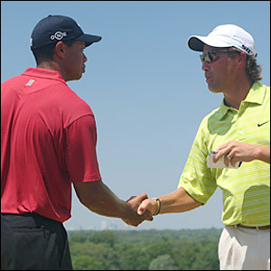 Tiger Woods (left) and Stephen Ames