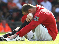 Wayne Rooney holds his foot after breaking a bone during Manchester United's 0-0 draw with Reading on Sunday