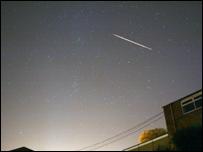 Shooting sky across a night sky