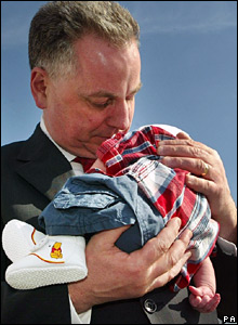 Jack McConnell holding a baby