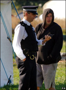 A police officer talks to one of the protestors