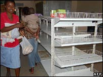 Zimbabwean shoppers looking at empty shelves