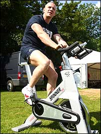 Mike Tindall pedals on a cycle machine at England's training camp