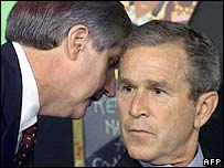 President George W Bush (right) listens to Chief of Staff Andrew Card deliver news of the 9/11 attacks, 2001