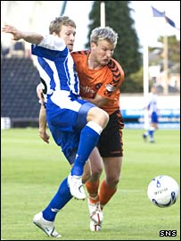 Kilmarnock forward Gary Wales (left) tries to force out Christian Kalvenes