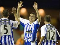 Colin Nish (centre) celebrates his late winner