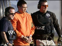 Jose Padilla escorted by police in a file photo from January 2006