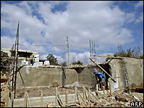 A man rebuilds his house in the village of Frun, 75km (47 miles) southeast of Beirut - 13/08/2007