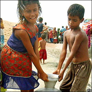 Children gather drinking water in Bashila, on the outskirts of Dhaka, Bangladesh.