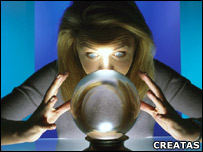 Woman gazing into a crystal ball
