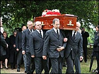 Pallbearers carrying Mike Reid