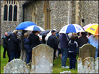Mourners gather outside Little Easton church