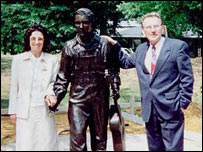 Maurice and Maureen Colgan with the statue of Elvis