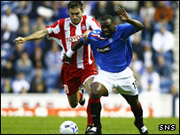 Rangers frontman Jean Claude Darcheville (right) sprints away from Grezgorz Bronowicki
