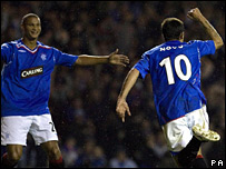 Nacho Novo (right) celebrates his late winner with Daniel Cousin