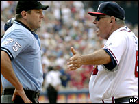 Cox argues with an umpire