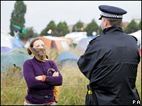 Protester and police officer at Heathrow camp