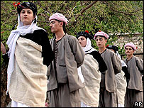Yazidis in traditional dress celebrate new year