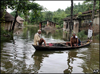 Local residents move around Bariyarpur village in Begusarai district, Bihar state