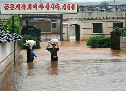 North Koreans wade through heavy flooding, August 2007 (Picture courtesy of World Food Programme)