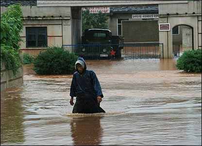 A North Korean wades through heavy flooding, August 2007 (Picture courtesy of World Food Programme)