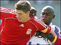 Liverpool captain Steven Gerrard (left) keeps Toulouse's Achille Emana at bay at the Stade Municipal as the Reds won 1-0