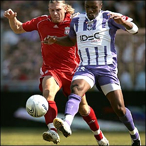 Liverpool's goalscorer Andriy Voronin and Albin Ebondo