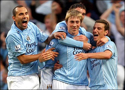 Manchester City celebrate Michael Johnson's opener