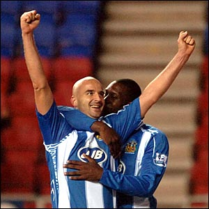 Antoine Sibierski celebrates scoring for Wigan