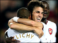 Arsenal players congratulate scorer Cesc Fabregas